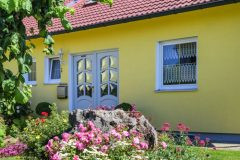 typical german bungalow with colorful front yard