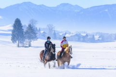two female riders in wintry nature